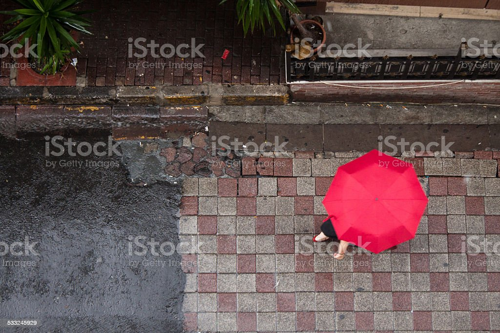 Red umbrella under rain stock photo