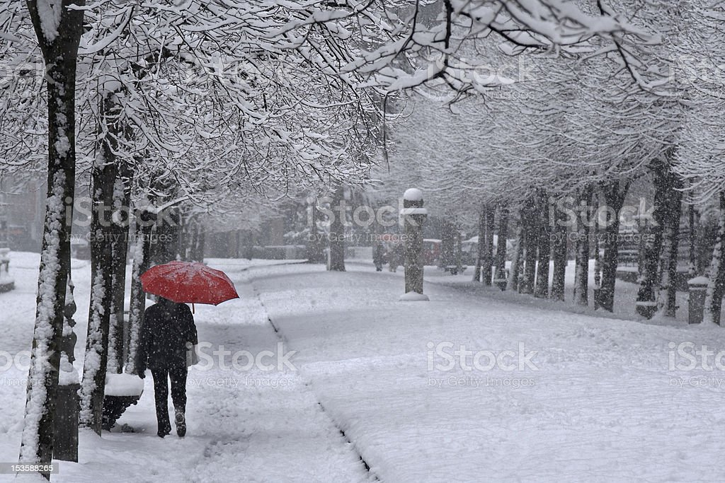 Red umbrella under the snow royalty-free stock photo