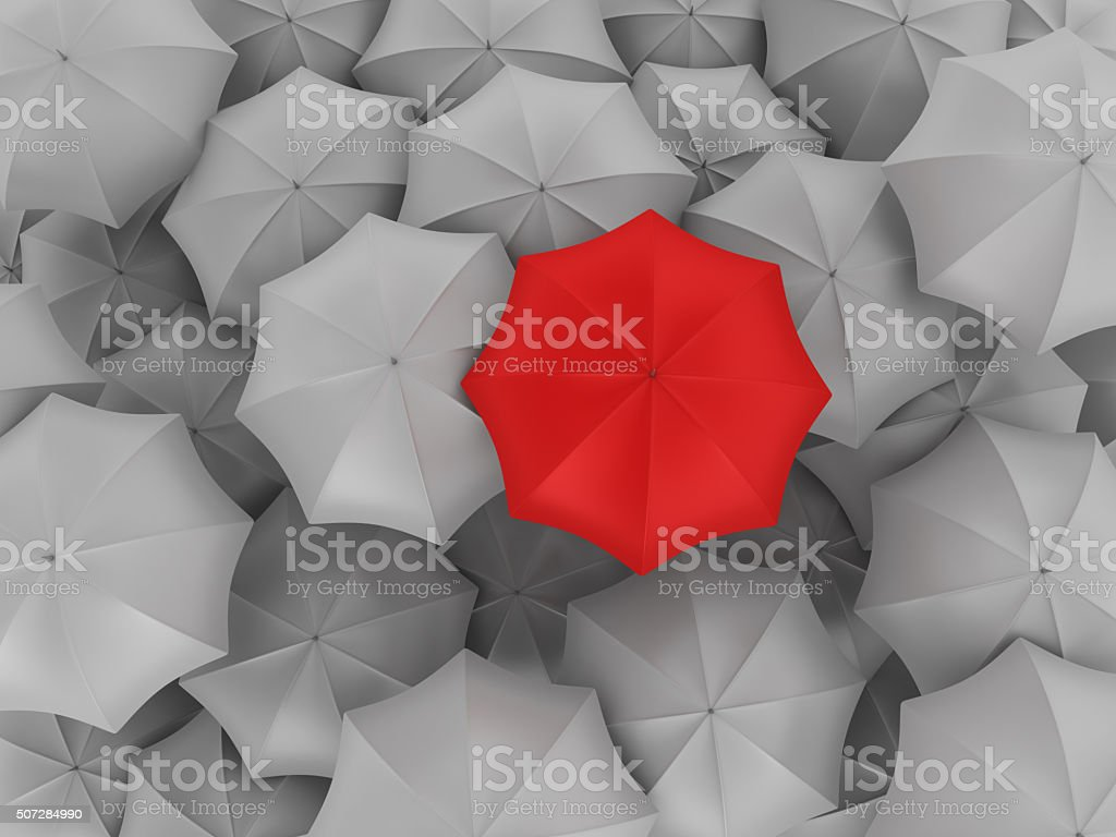 Red Umbrella with Many Gray Ones stock photo