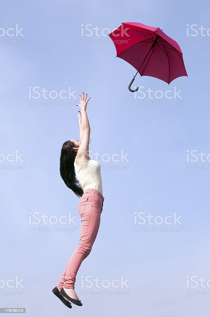 red umbrella woman jump to blue sky royalty-free stock photo