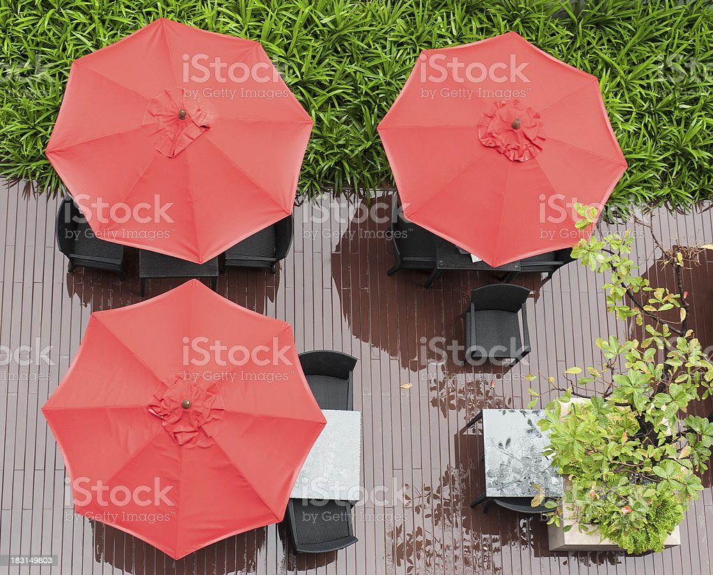 red umbrellas and chairs stock photo