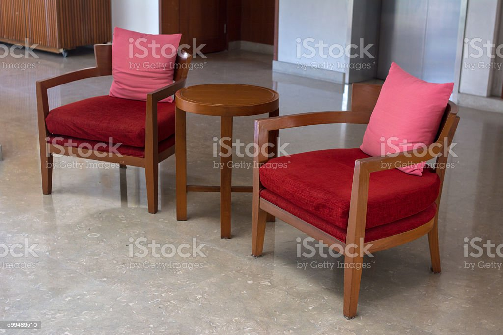 Red upholstered wooden chair stock photo