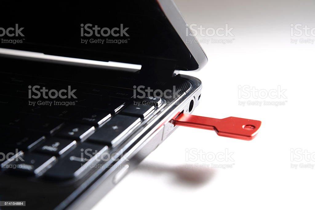 red usb key on black keyboard stock photo