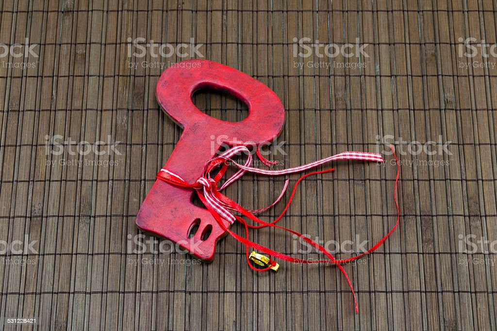 Red Valantines key on a wooden surface royalty-free stock photo