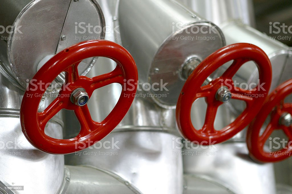 red valves with stainless steel pipes royalty-free stock photo