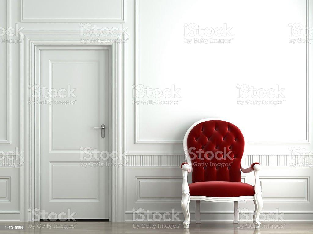 red velvet armchair on white wall stock photo
