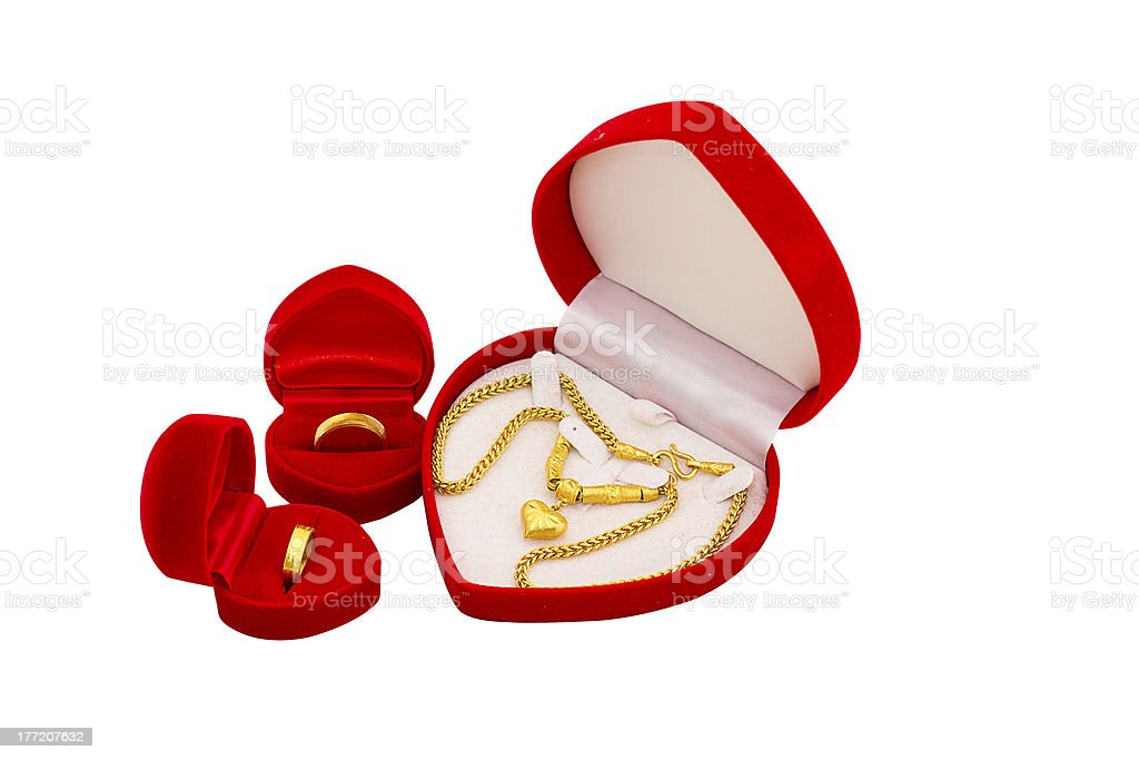 Red velvet box with golden ring and gold necklace royalty-free stock photo