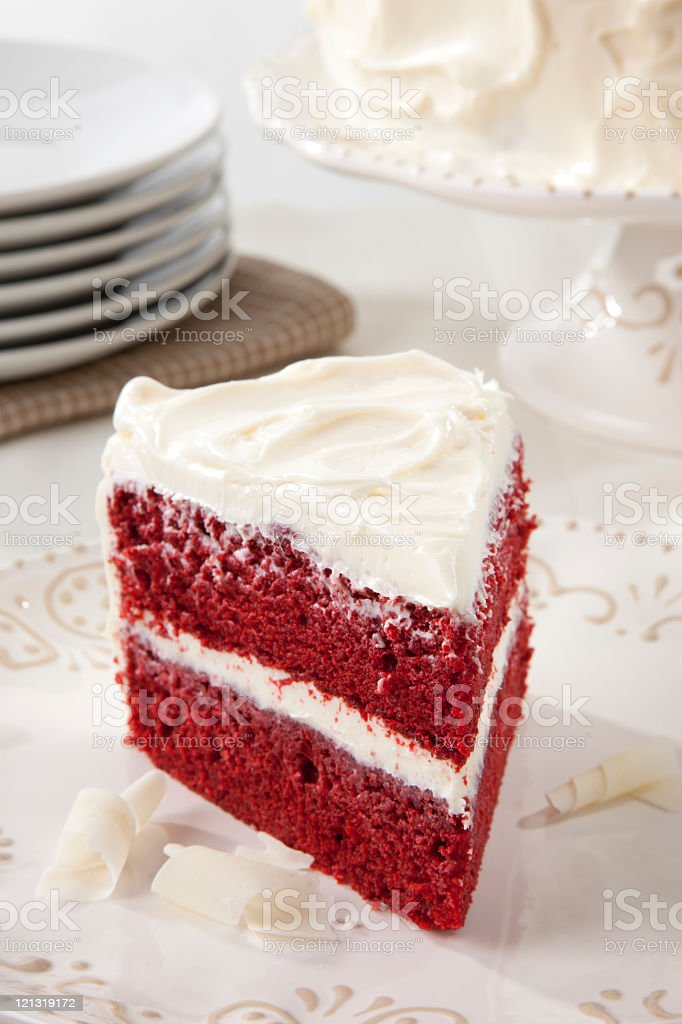 Red Velvet Cake and Stacked Plates royalty-free stock photo