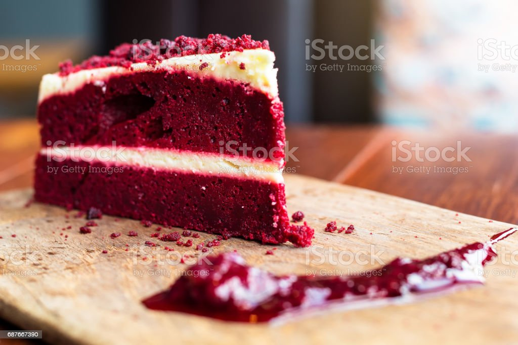 Red velvet cake on wood plate with sauce stock photo