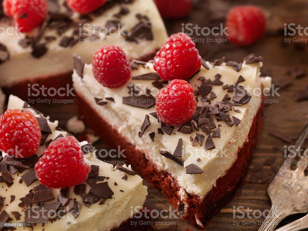 Red Velvet Cheesecake with Fresh Berry's stock photo