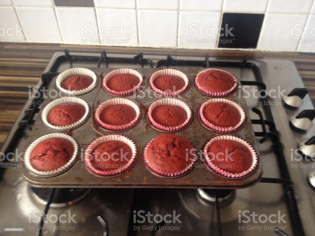 Red Velvet cupcakes fresh in the tin stock photo