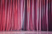 Red velvet curtains.