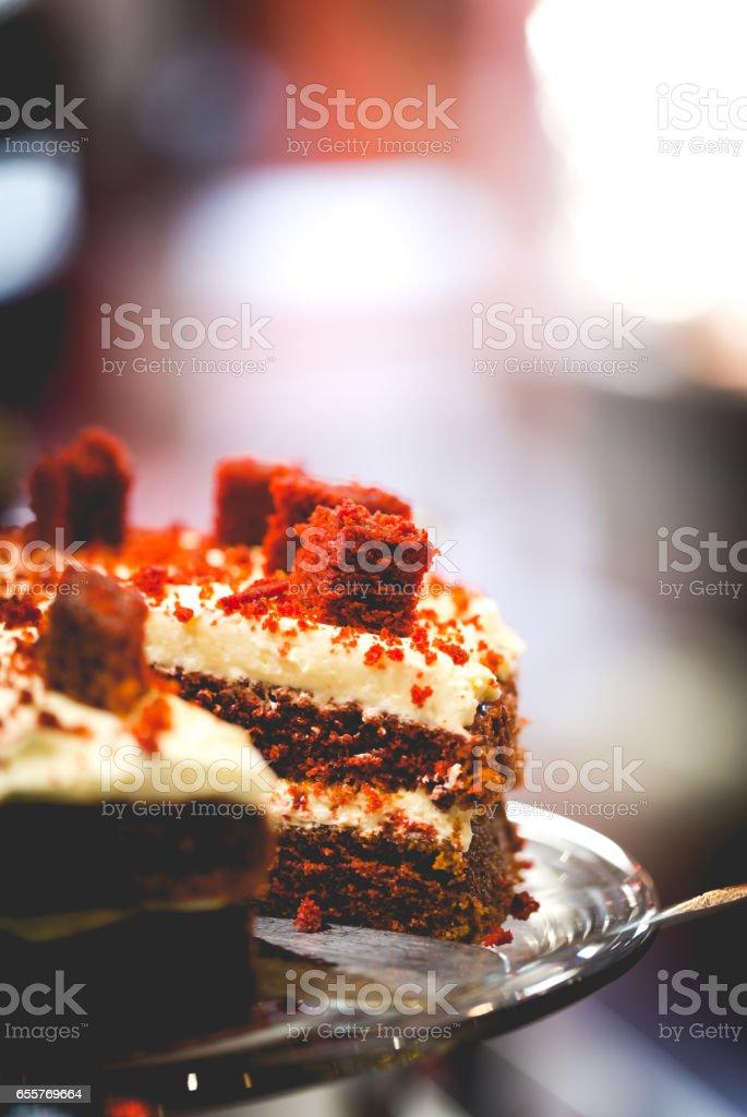 Red velvet frosting cake on shop shelves stock photo