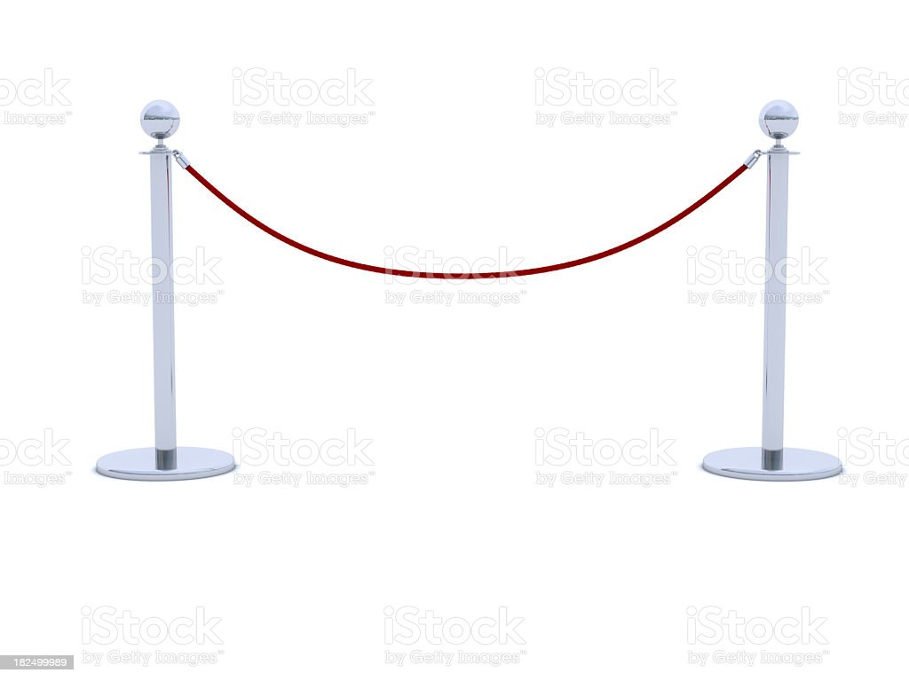 Red velvet rope barrier with silver posts stock photo