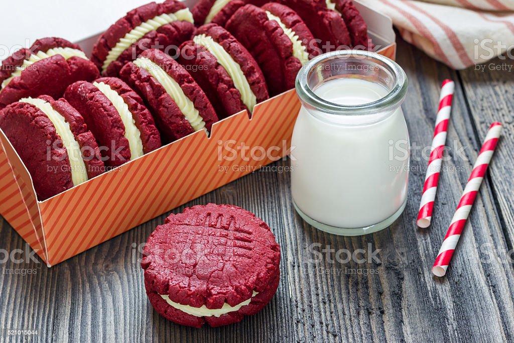 Red velvet sandwich cookies with milk stock photo