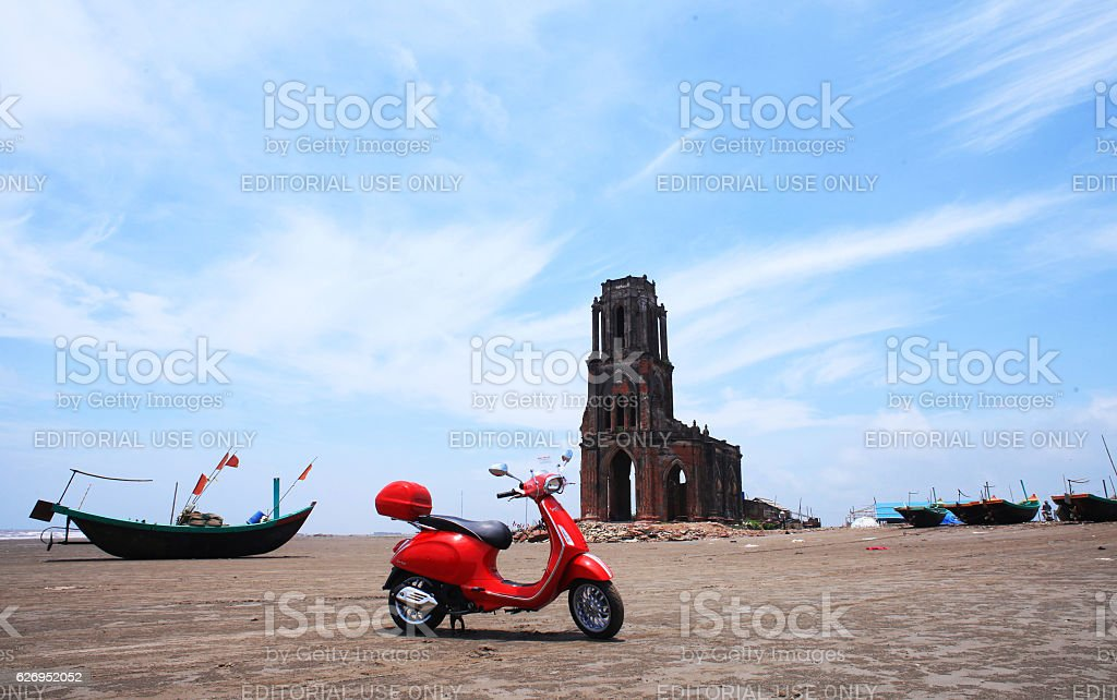 Red Vespa motorcycle stock photo