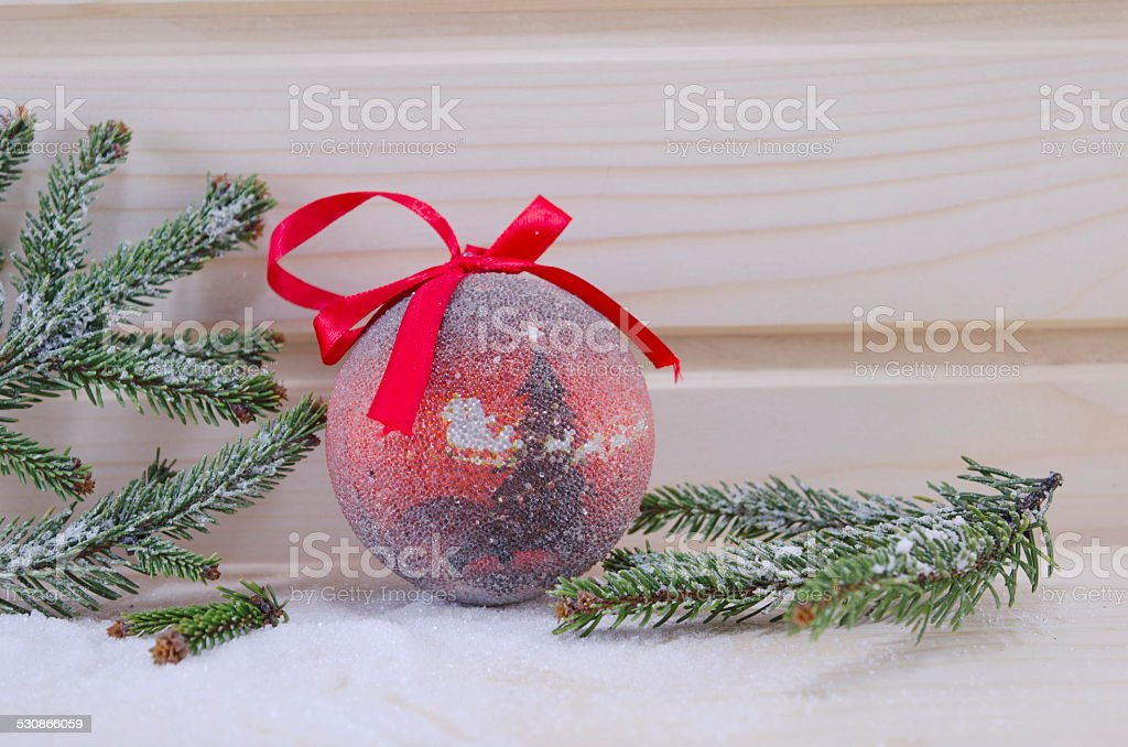 Red vintage Christmas ornament with fir branches royalty-free stock photo