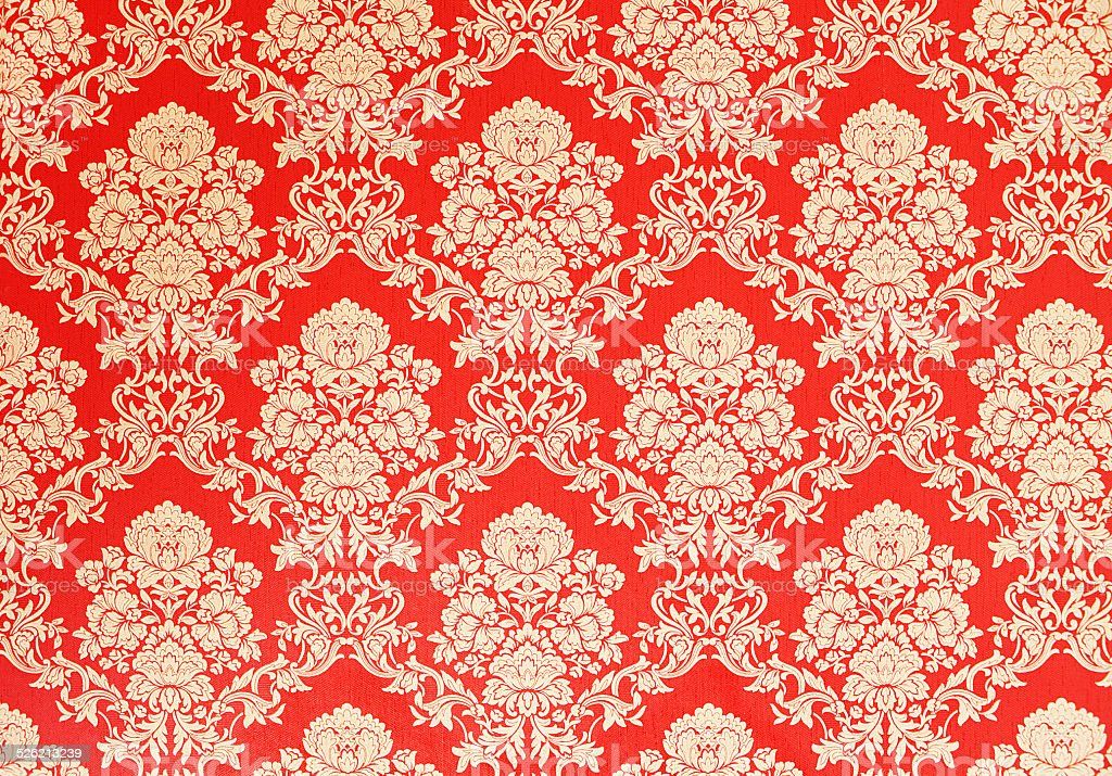 red vintage wallpaper with golden baroque ornaments stock photo