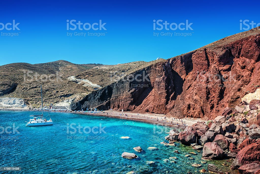Red Volcanic Beach with Turquoise Water on Santorini, Greece stock photo