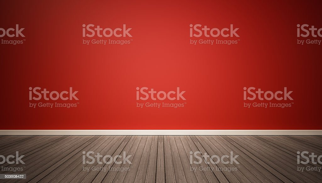 Red wall and dark wood floor stock photo
