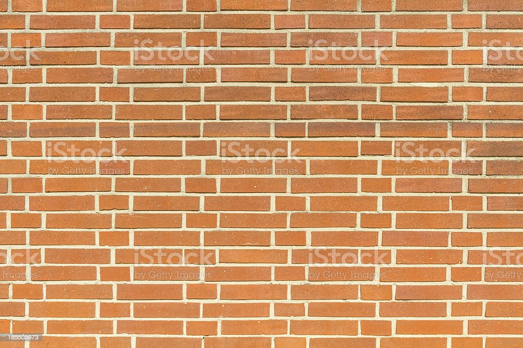 Red wall of bricks with grey seams stock photo