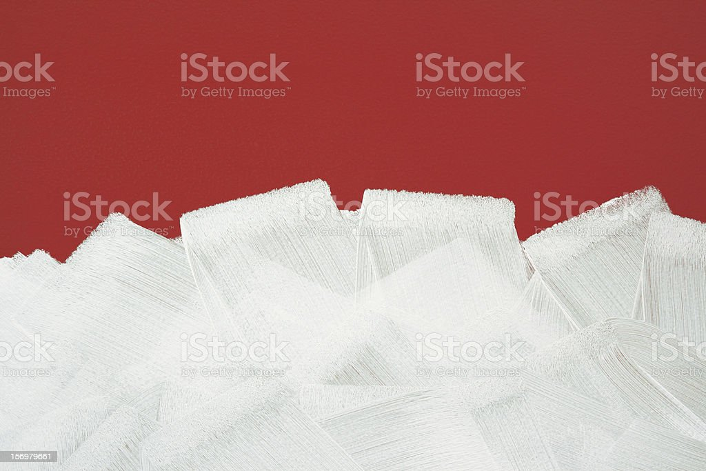 Red wall painted in white with paint roller royalty-free stock photo