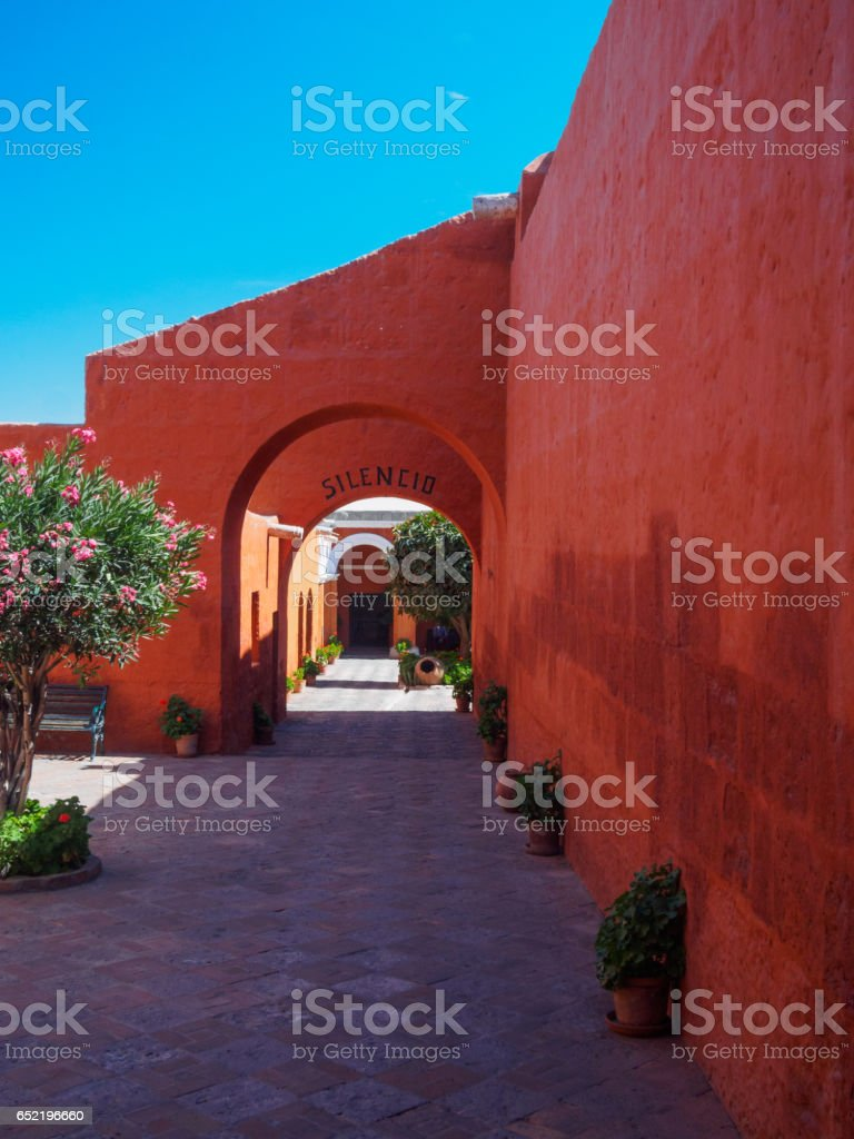 Red walls in one of the streets of Santa Catalina Monastery of Arequipa stock photo