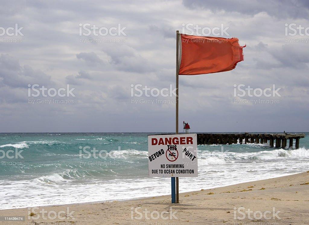 Red Warning Flag at the beach, Boca Raton, Florida royalty-free stock photo