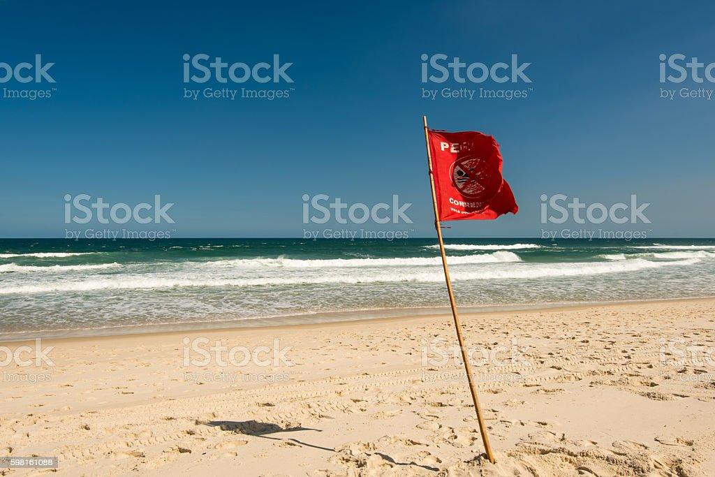 Red Warning Flag stock photo