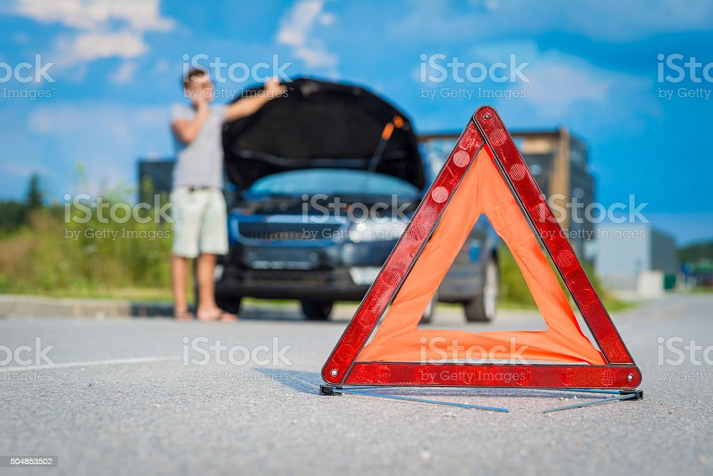 Red warning triangle stock photo