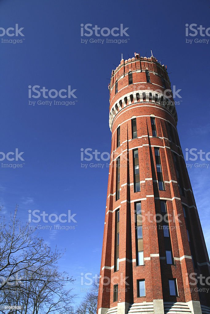 Red water tower stock photo