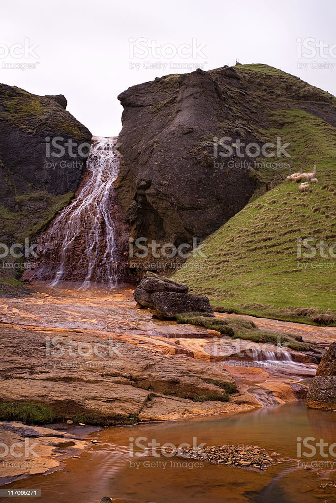 Red Waterfall Near Kirkjubæjarklaustur stock photo