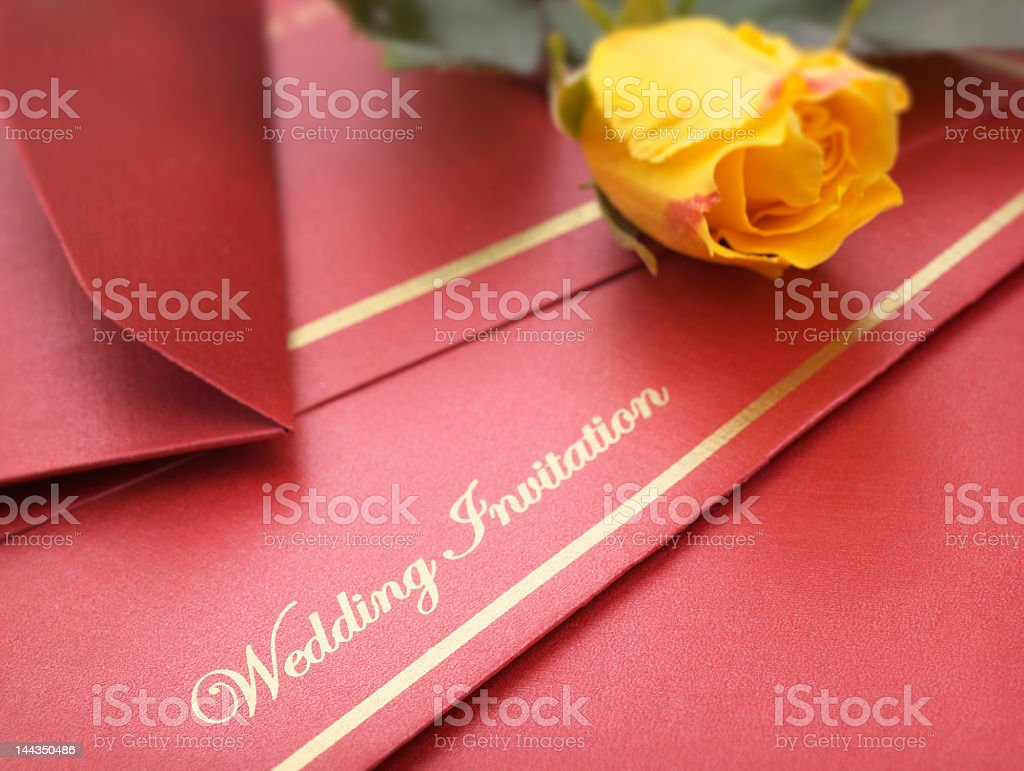 A red wedding invitation with yellow flowers stock photo