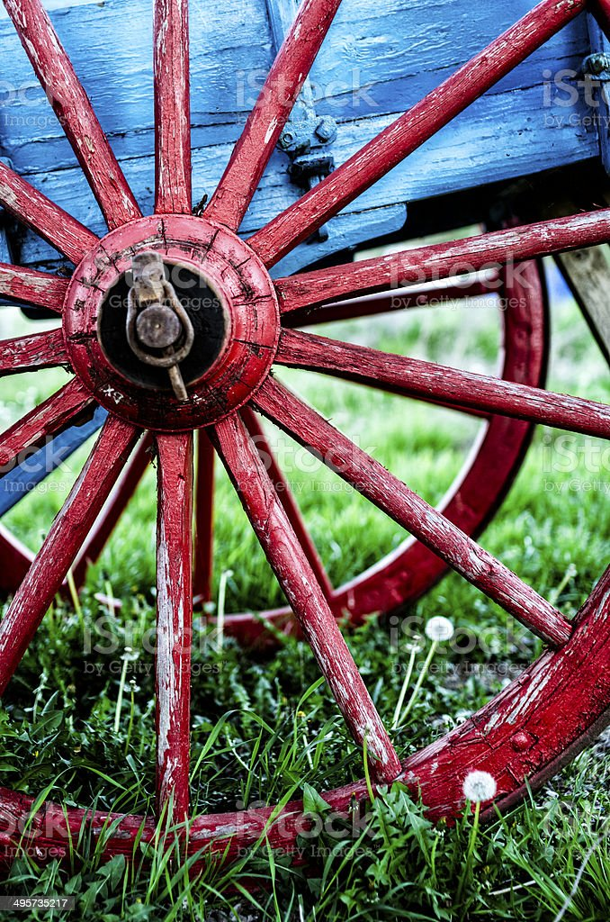 red wheel of an old wooden colored wagon stock photo