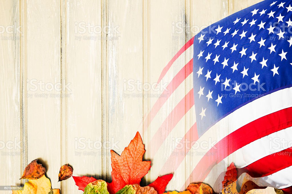 Red, white and blue American flag on autumn leaf background. stock photo