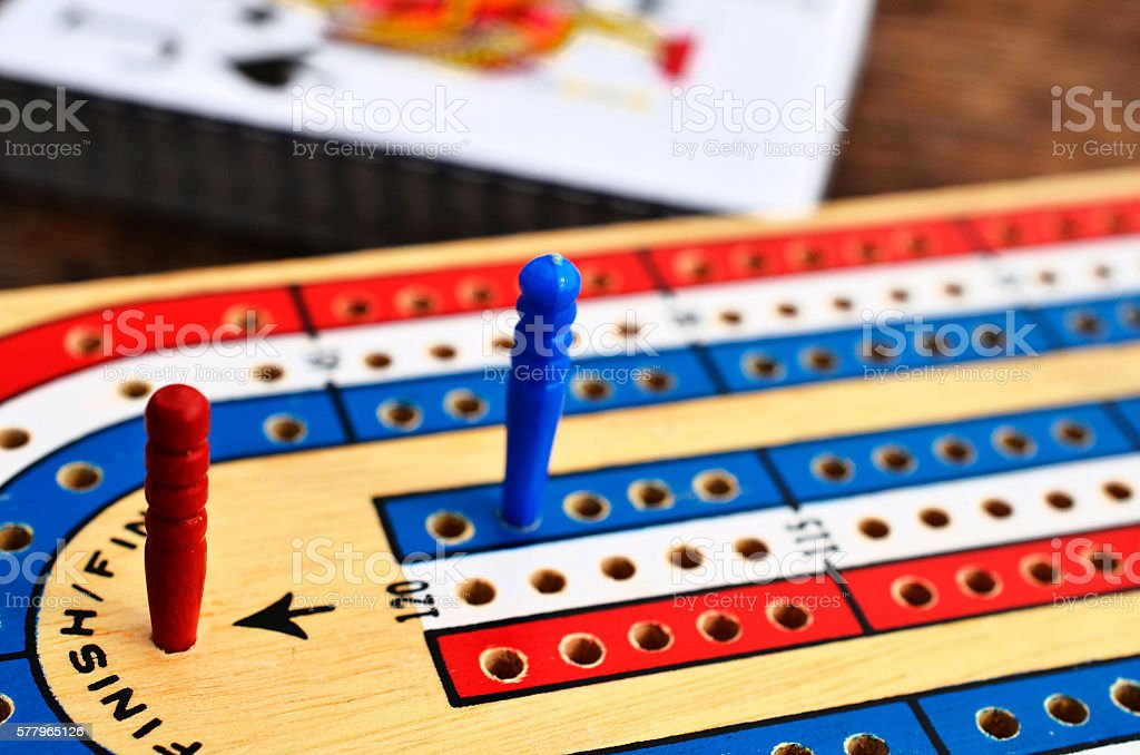 Red, White, and Blue Cribbage Board stock photo