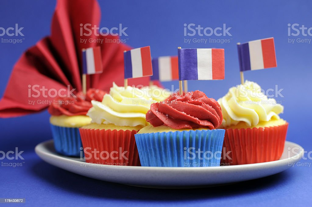Red, white and blue cupcakes with flags of France stock photo