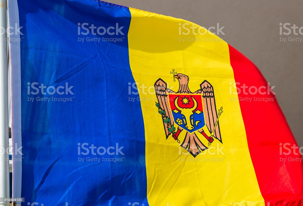 Red, White and Blue Flag of Moldova Blowing In Wind stock photo
