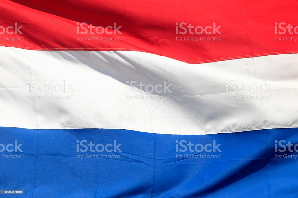 A red, white and blue Netherlands flag flying proudly stock photo