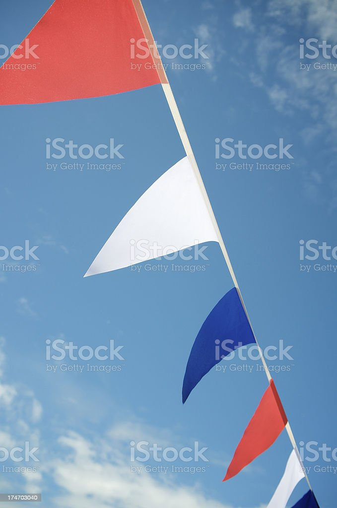 Red White and Blue Pennant Flags Across Sky royalty-free stock photo