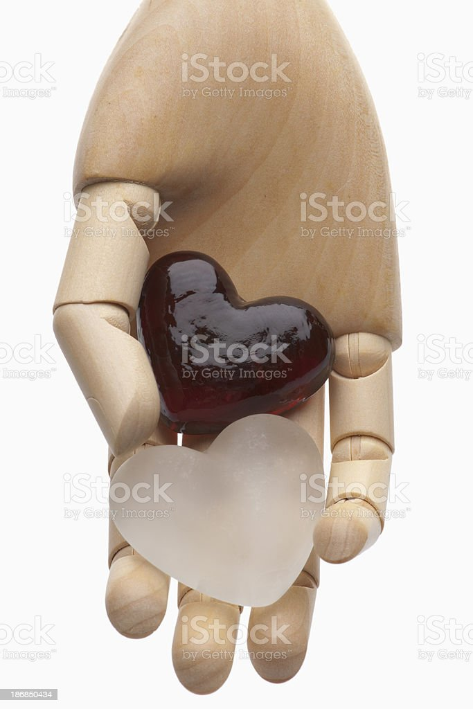 Red & White Glass Hearts in Hand stock photo