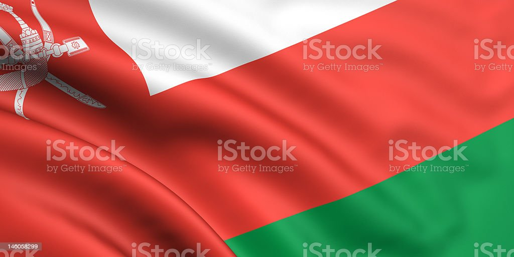 Red, white & green striped flag of Oman with dagger & swords stock photo