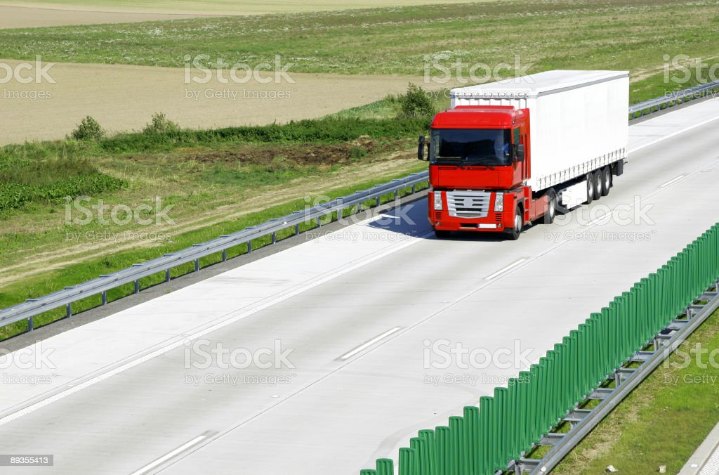 Red white truck on highway royalty-free stock photo