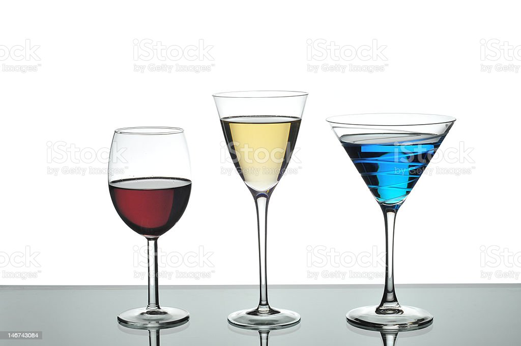 Red white wine and blue martini drinks in glasses royalty-free stock photo