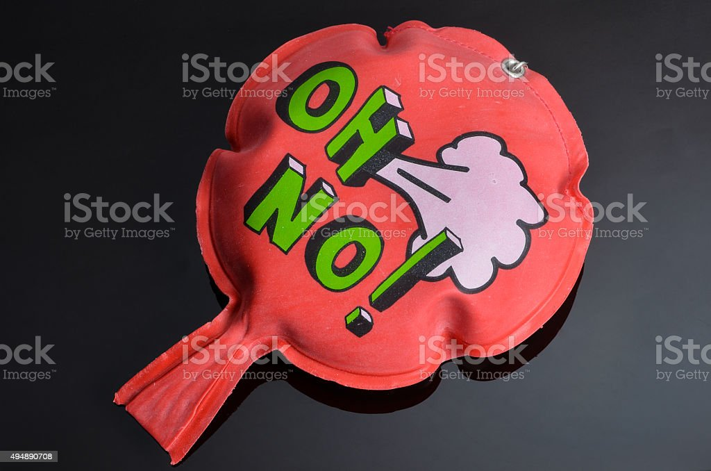red whoopee cushion with reflection on black glass stock photo
