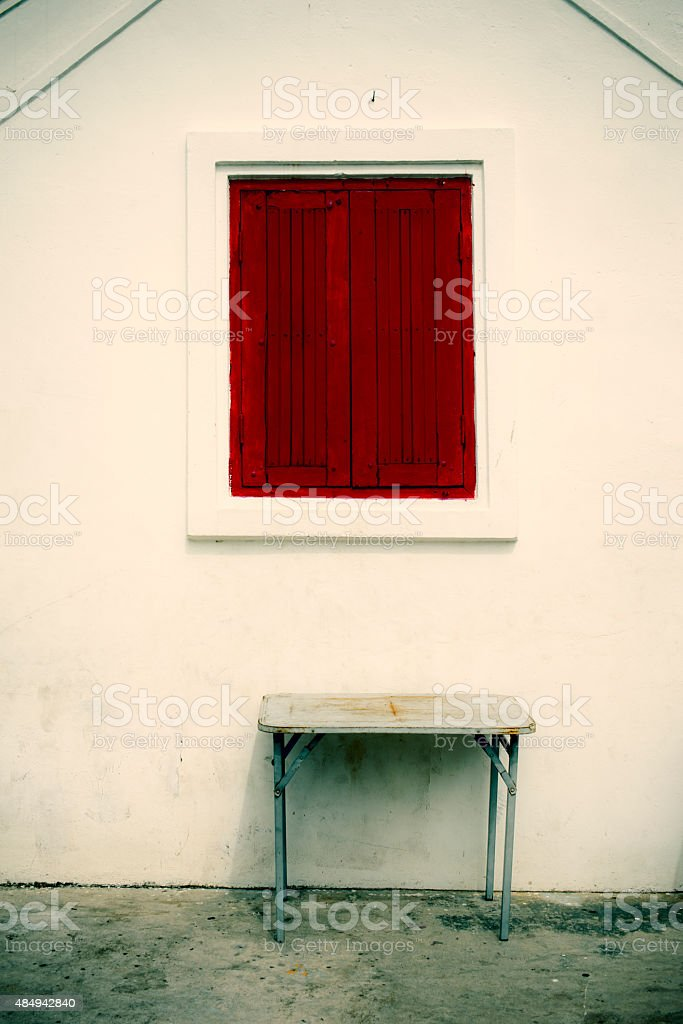 Red window on white wall royalty-free stock photo