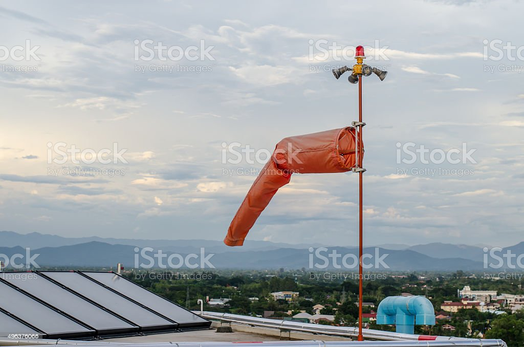 Red windsock inflated by the wind blows stock photo