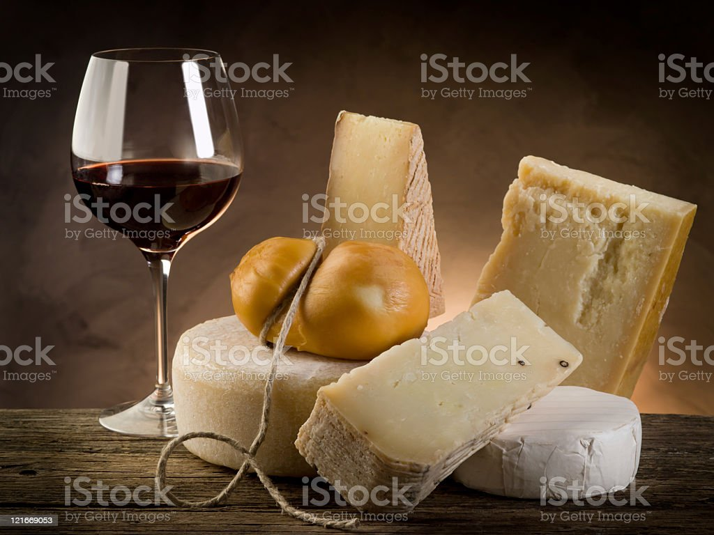 Red wine and a variety of cheese stock photo