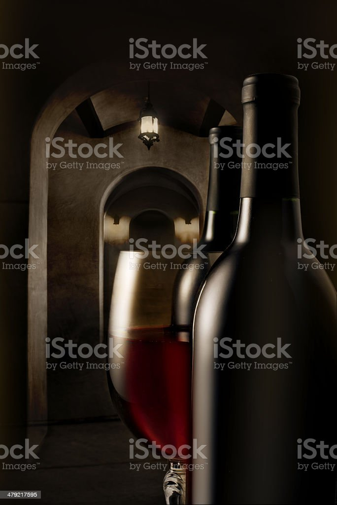 Red wine and bottles in cellar royalty-free stock photo