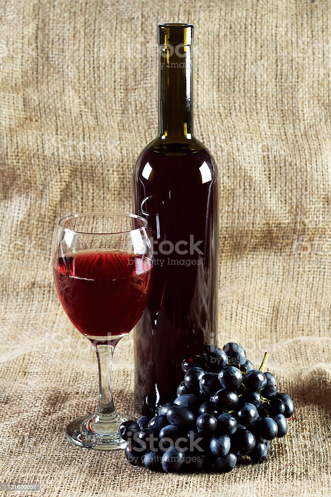 Red wine and grapes on vintage background royalty-free stock photo